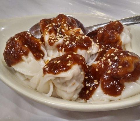 Dumplings in spicy peanut sauce