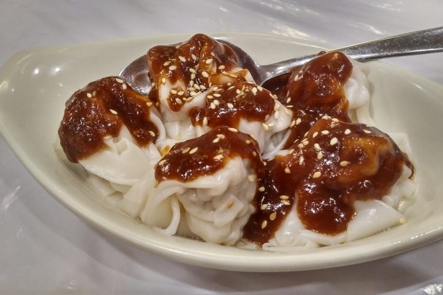 Dumplings in spicy peanut sauce