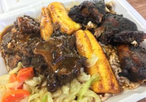Jerk chicken and oxtail combo - Ochos Rios